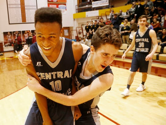 Kavon Clark and his Central Catholic teammate Jonah Switzer celebrate after the Knights beat McCutcheon 53-52 Friday, January 5, 2018, at McCutcheon. Clark hit the go ahead basket for CC.