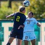 UVM'S Nikki McFarland, right, and Kent State's Madison Helterbran try to get their heads on the ball in Burlington on Friday, September 4, 2015.
