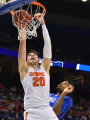 Syracuse's Tyler Lydon dunks while Middle Tennessee's