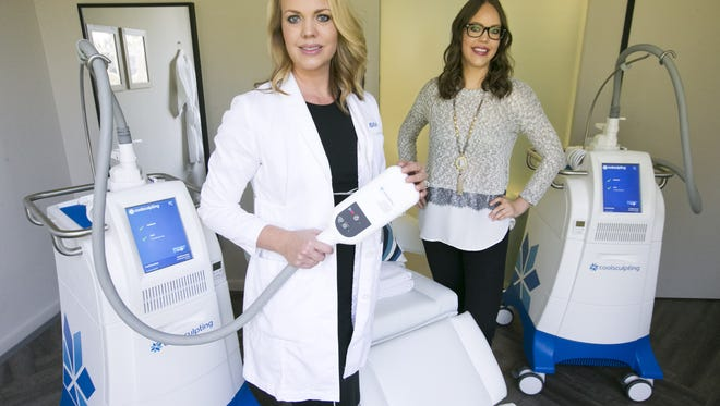 Sisters, Melissa Mickelson (left) and Jessica Johnson are co-founders of Bodify. They are seen in a Bodify treatment room with the CoolSculpting machine in Phoenix on Tuesday, December 13, 2016.