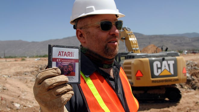 Film Director Zak Penn shows a box of a decades-old Atari 'E.T. the Extra-Terrestrial' game found in a dumpsite in Alamogordo, N.M., Saturday, April 26, 2014. Producers of a documentary dug in a southeastern New Mexico landfill in search of millions of cartridges of the game that has been called the worst game in the history of video gaming and were buried there in 1983.