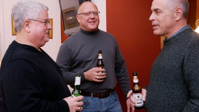 Terry Jobbitt, Paul Modson and Tom Cassidy share a beer and conversation during a Boys and Brews gathering.