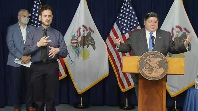 Gov. JB Pritzker answers reporters' questions during a news conference in Chicago on Tuesday about the state's guidance for Illinois schools to reopen for in-person learning this fall.