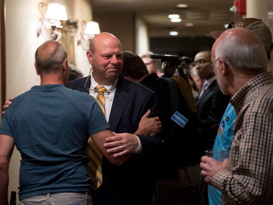 Lee Tramel is approached by supporters as early election