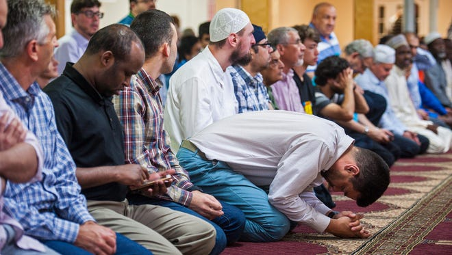Congregants pray at the Islamic Society of Vermont in Colchester on Friday, July 14, 2017.