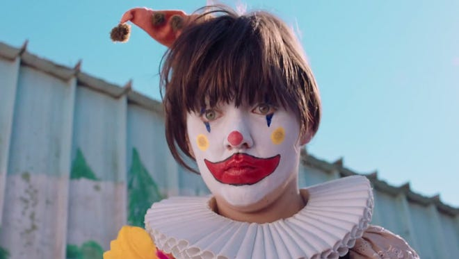 """Courtney Barnett as a sad happy clown in the video to """"Pedestrian at Best."""""""