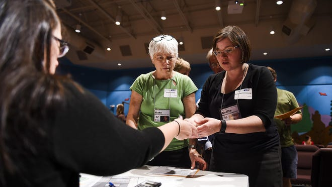 Diana Gartner and Amanda Armstrong participate in a community-wide poverty simulation hosted by the Coloradoan with United Way of Larimer County Thursday, Sept. 21, 2015. The simulation is designed to give people a taste of what it is like to live in poverty. According to recently released data from the U.S. Census Bureau, an estimated 18.3 percent of Fort Collins residents live in poverty.