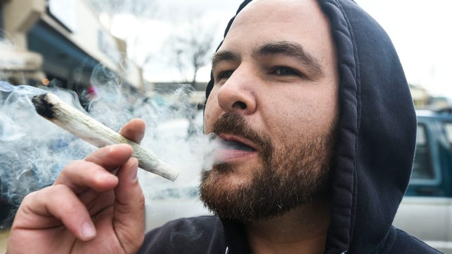 Noah Sugarman smokes marijuana during a 4/20 party held Monday at The Joint Smoke Shop in Fort Collins. The first retail marijuana store in Larimer County opened in April 2014.
