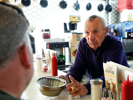 Anton's Coffee Shop owner Anton Tasich talks with Eric Wood, a regular costumer of the popular Springfield breakfast spot on Dec. 3, 2015.