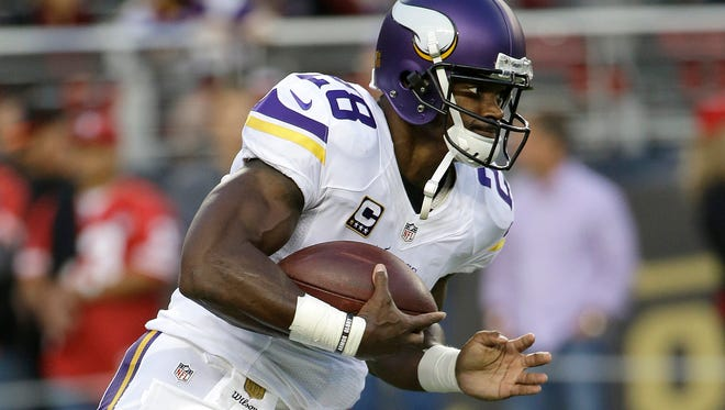 Minnesota Vikings running back Adrian Peterson warms up before a NFL game Monday against the San Francisco 49ers in Santa Clara, Calif.