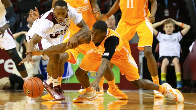 Jan 7, 2015; Starkville, MS, USA; Mississippi State Bulldogs guard Craig Sword (32) and Tennessee Volunteers guard Devon Baulkman (34) go after the loose ball during the game at Humphrey Coliseum. Mandatory Credit: Spruce Derden-USA TODAY Sports