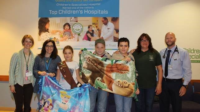 Girl Scouts of Troup 70042 in Hamilton made and delivered princess- and dinosaur-themed baby blankets to Children's Specialized Hospital in Hamilton.