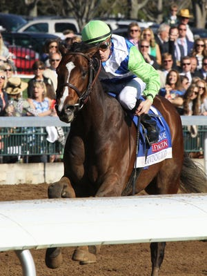 Divining Rod wins the Coolmore Lexington Stakes April 11.