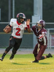 Rossview's Fred Orr (2) escapes the clutches of a Station