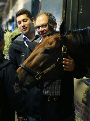 Owner Ahmed Zayat shares a moment with American Pharoah on Sunday morning at Keeneland.