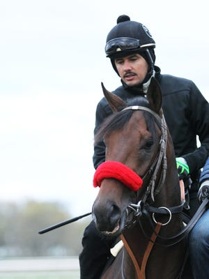 Early Kentucky Derby favorite Nyquist jogged Saturday at Keeneland.
