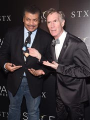 """Astrophysicist Neil deGrasse Tyson and Educator Bill Nye attend a screening of """"The Space Between Us"""" hosted by The Cinema Society at Landmark Sunshine Cinema on January 25, 2017 in New York City.  (Photo by Jamie McCarthy/Getty Images)"""