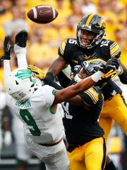 Iowa safety Miles Taylor, front, helped cornerback Josh Jackson (15) learn how to get his life in order to do what it takes to become a big-time player. Both are in their fourth year in the Hawkeye program.