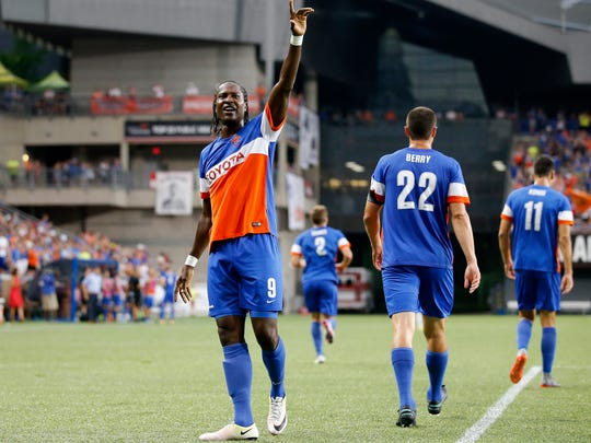 FC Cincinnati forward Djiby Fall (9) celebrates after scoring in the first half during the USL match between Harrisburg City Islanders and FC Cincinnati, Saturday, July 22, 2017, at Nippert Stadium in Cincinnati.