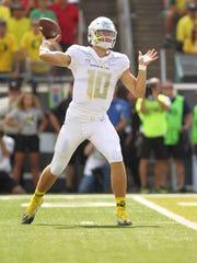 Oregon quarterback Justin Herbert (10) threw for 365 yards, three touchdowns and one interception against the Nebraska Cornhuskers.