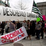 Marijuana activists attempt to bring a 51-foot inflatable joint down Pennsylvania Avenue to the White House on April 2, 2016.