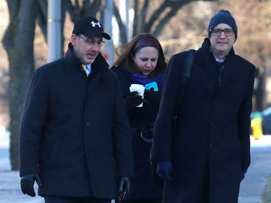 Aaron Troodler, left, enters the White Plains federal courthouse on Jan. 2 for sentencing on security fraud in connection with the case against Christopher St. Lawrence.