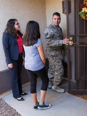 Sgt. Jesus Garcia, his wife Ruth and daughter Sara, 11, look at a home they are buying in Peoria, Ariz., on May 17, 2017.