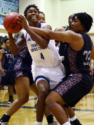 Texas A&M-Corpus Christi's Camesha Davis (4) is fouled driving to the basket by Texas Southern's Nycolle Smith (32) during their game at the Dugan Wellness Center on Wednesday, Nov. 16, 2016. The Islanders will play Schreiner College on Tuesday.