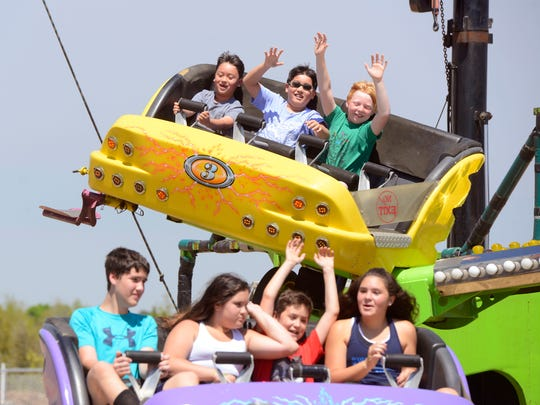 Kids ride the Catch 'N Air Sunday at the Santa Rosa