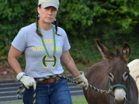 Becky Sharpe escorts Xote onto the field.