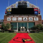 "The Johnny Unitas Statue is an iconic figure that looks out toward Papa John's Cardinal Stadium at the north end zone outside the Howard Schnellenberger Football Complex. The University of Louisville plans to expand Papa John's Cardinal Stadium to 65,000 seats. About 10,000 seats will be added with the expansion, including 1,000 club seats and 65 ""premium"" loge level seats as well as 10 field level suites. The design will connect the east and west sides of the stadium. Athletic Director Tom Jurich says he plans to have the expansion completed in the next two years, though no completion date has been set. The project cost is an estimated $55 million, raised through sponsorships, private donations and ticket sales. Aug. 27, 2015"
