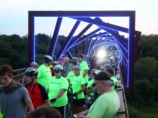 An estimated 400 cyclists and supporters of Wade Franck rode out to the High Trestle Trail bridge in Madrid on Wednesday, Aug. 26, 2015.