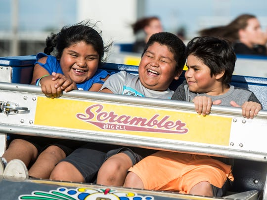 People ride the Scrambler at the Wayne County 4H Fair in Richmond on Monday, June 25, 2018.