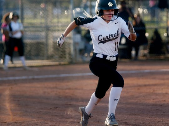 Central Magnet's Alyssa Ward (11) runs to first during