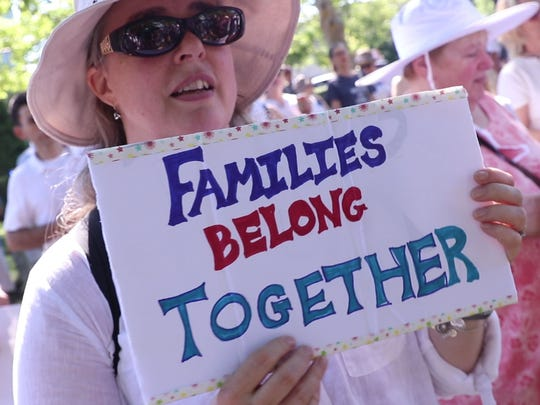 Protesters gather during the 'Families Belong Together'