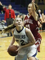 Sheboygan North's Mariah Platz (52) looks to go up for a shot during a nonconference game against Fond du Lac.