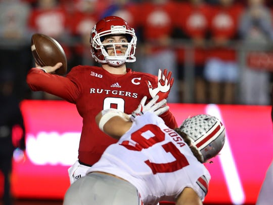 Rutgers quarterback Kyle Bolin (9) throws a pass as