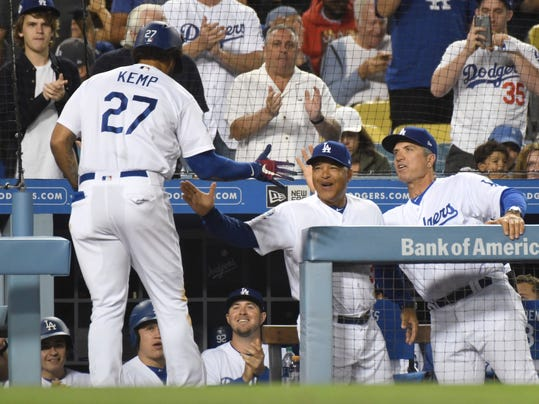 Los Angeles Dodgers' Matt Kemp (27) is greeted at the dugout by manager Dave Roberts after hitting a solo home run in the sixth inning of a baseball game against the Oakland Athletics, Tuesday, April 10, 2018, in Los Angeles. (AP Photo/Michael Owen Baker)