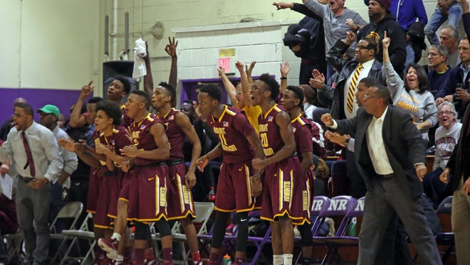 The Mount Vernon bench and fans celebrate when the team takes the lead in the third quarter of game action against New Rochelle at New Rochelle High School on Jan 4, 2016. Mount Vernon defeated New Rochelle 72-63.