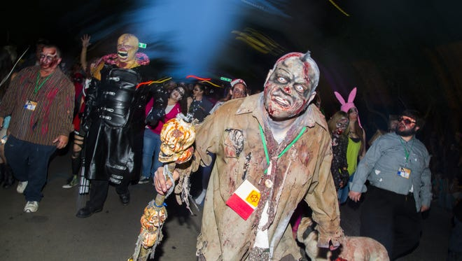 G Digger, played by Michael Aguirre, makes his way to eat some humans during the ComiCon Zombie Walk in Phoenix, AZ on May 29, 2015.