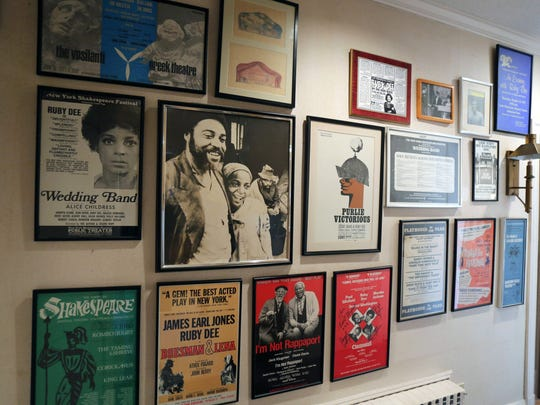 Theatrical posters line a hallway in the 5-bedroom, 5-bath Mediterranean home for sale in New Rochelle, that was the home of Ossie Davis and his wife Ruby Dee, photographed Nov. 24, 2015.
