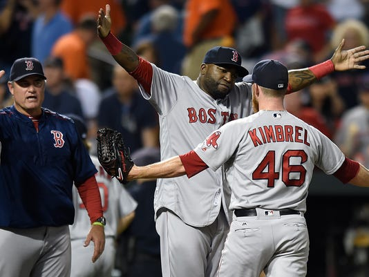 Boston Red Sox designated hitter David Ortiz, center hugs closing pitcher Craig Kimbrel after defeating the Baltimore Orioles 5-3 in a baseball game to sweep a four game series, Thursday, Sept.. 22, 2016, in Baltimore. (AP Photo/Gail Burton)