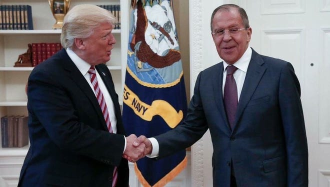 This handout photo released by the Russian Ministry of Foreign Affairs, shows President Trump meeting with Russian Foreign Minister Sergey Lavrov in the Oval Office of the White House on May 10, 2017. ORG XMIT: