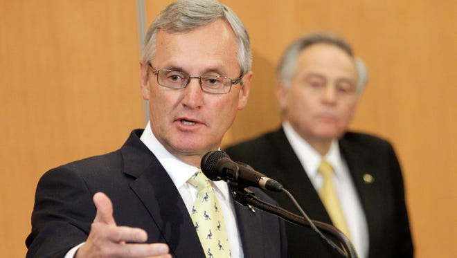 Former Ohio State football coach Jim Tressel speaks after being introduced as the new vice president for strategic engagement at the University of Akron on Feb. 2, 2012.