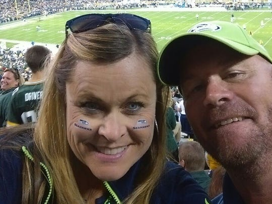 Seahawks fan Kimberly Russell and her fiance take a selfie inside Lambeau Field.