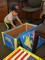 The first child to receive a toy box made by Cornerstone Search Group associates was 1½-year-old Ethan, who chose a toy box with a sea creatures motif. Thanks to Cornerstone, Ethan also received a carton full of new toys and art supplies.