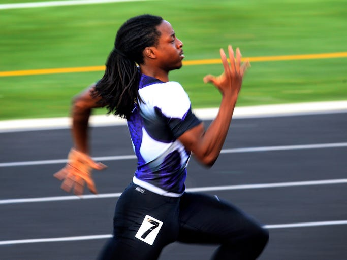 Ben Davis' Derrick Jones sprints down the track to win the 200 meter dash in 21.99 seconds at the high school boys regional track meet at North Central High School in Indianapolis on Thursday, May 29, 2014.