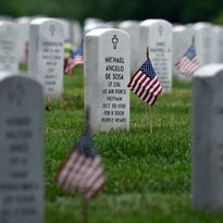 Every headstone at Arlington National Cemetery in Arlington, Va., has a flag placed in front of it on May 21.
