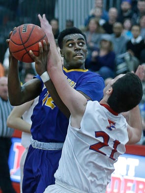 Irondequoit's Alex Goldsberry faces a block from Fairport's
