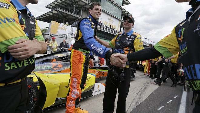 IndyCar driver Stefan Wilson (25) thanks his team members following his qualifying run for the 100th running of the Indianapolis 500 Saturday, May 21, 2016, morning at the Indianapolis Motor Speedway.